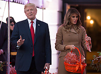 United States President Donald J. Trump reacts to a reporter's question while handing out treats with  First Lady Melania Trump give during a Halloween event at The White House in Washington, DC, October 30, 2017. <br /> Credit: Chris Kleponis / CNP /MediaPunch /NortePhoto.com