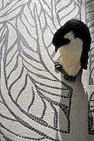 Twiggy stone mosaic in tumbled Botticino and Chinese Black.<br /> -courtesy of James Duncan