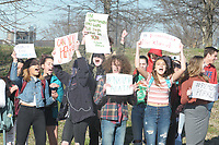 NWA Democrat-Gazette/DAVID GOTTSCHALK  Bentonville High School students hold signs Wednesday, March 14, 2018, before a a 17 minute silent observance for the shooting victims  Marjory Stoneman Douglas High School in Parkland, Florida. About 400 students from the school participated in the silence and a series of chants and speeches as they lined S.E. J Street in Bentonville.