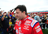 Feb 22, 2009; Fontana, CA, USA; NASCAR Sprint Cup Series driver Tony Stewart heads to driver introductions prior to the Auto Club 500 at Auto Club Speedway. Mandatory Credit: Mark J. Rebilas-