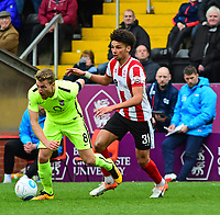 York City's Simon Heslop gets away from Lincoln City's Lee Angol<br /> <br /> Photographer Andrew Vaughan/CameraSport<br /> <br /> Buildbase FA Trophy Semi Final Second Leg - Lincoln City v York City - Saturday 18th March 2017 - Sincil Bank - Lincoln<br />  <br /> World Copyright &copy; 2017 CameraSport. All rights reserved. 43 Linden Ave. Countesthorpe. Leicester. England. LE8 5PG - Tel: +44 (0) 116 277 4147 - admin@camerasport.com - www.camerasport.com