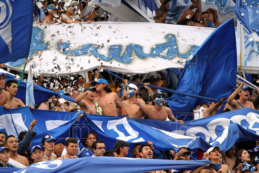 BOGOTA -COLOMBIA- 15 -09-2013. Hinchas de Los Millonarios durante el partido contra el Independiente  Santa Fe , partido correspondiente a la novena fecha de La Liga Postobon segundo semestre jugado en el estadio Nemesio Camacho El Campin /  Fans of the Millionaires during the game against Independiente Santa Fe, game in the ninth round of La Liga Postobon second half played in the Estadio Nemesio Camacho El Campin  .Photo: VizzorImage / Felipe Caicedo / Staff
