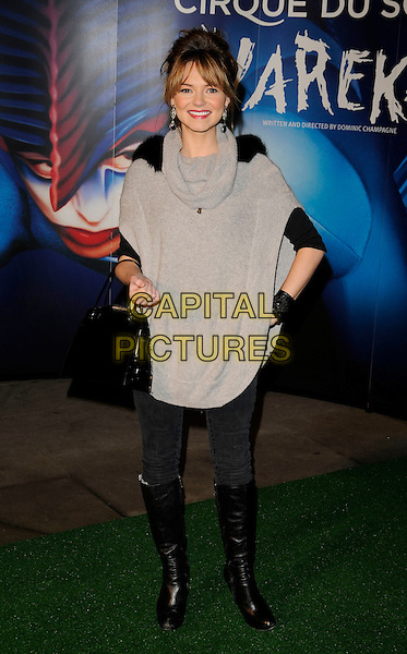 "KARA TOINTON.Attending the Cirque Du Soleil ""Varekai"" Premiere at the Royal Albert Hall, London, England, January 8th 2007..full length grey sweater jumper top black fur shoudler boots hands on hips bag.CAP/CAN.©Can Nguyen/Capital Pictures"