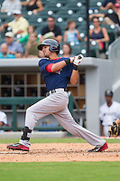 Derrik Gibson (16) of the Pawtucket Red Sox follows through on his swing against the Charlotte Knights at BB&T Ballpark on August 8, 2014 in Charlotte, North Carolina.  The Red Sox defeated the Knights  11-8.  (Brian Westerholt/Four Seam Images)