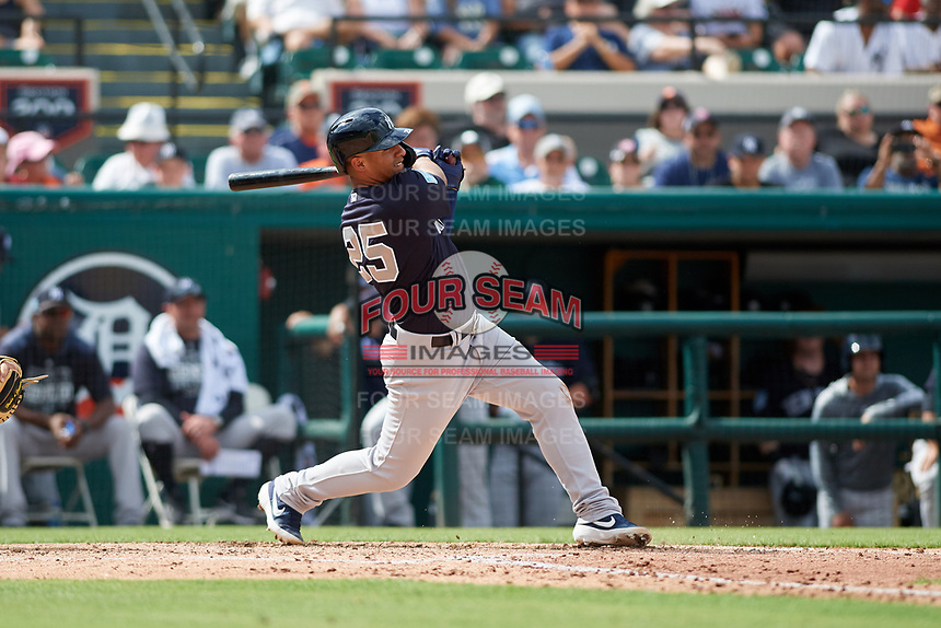 New York Yankees shortstop Gleyber Torres (25) follows through on a swing during a Grapefruit League Spring Training game against the Detroit Tigers on February 27, 2019 at Publix Field at Joker Marchant Stadium in Lakeland, Florida.  Yankees defeated the Tigers 10-4 as the game was called after the sixth inning due to rain.  (Mike Janes/Four Seam Images)