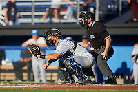 Hudson Valley Renegades catcher Daniel De La Calle (13) and umpire John Budka await the pitch during a game against the Batavia Muckdogs on August 1, 2016 at Dwyer Stadium in Batavia, New York.  Hudson Valley defeated Batavia 5-1.  (Mike Janes/Four Seam Images)