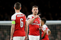 Arsenal's Aaron Ramsey talks tactics with his captain, Laurent Koscielny during Arsenal vs Rennes, UEFA Europa League Football at the Emirates Stadium on 14th March 2019