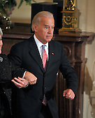 Washington, D.C. - May 1, 2009 -- United States Vice President Joseph Biden catches himself as he tripped off the steps following the ceremonial swearing-in of Commerce Secretary Gary Locke and Health and Human Services Secretary Kathleen Sebelius in the East Room of the White House in Washington, D.C. on Friday, May 1, 2009. <br /> Credit: Ron Sachs / CNP