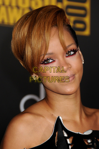 RIHANNA (Robyn Rihanna Fenty).The 2009 American Music Awards held at The Nokia Theatre L.A. Live in Los Angeles, California, USA. .November 22nd, 2009.AMA AMA's headshot portrait eyeliner eyeshadow pink make-up black white strapless cut out away perforated .CAP/ADM/BP.©Byron Purvis/AdMedia/Capital Pictures.