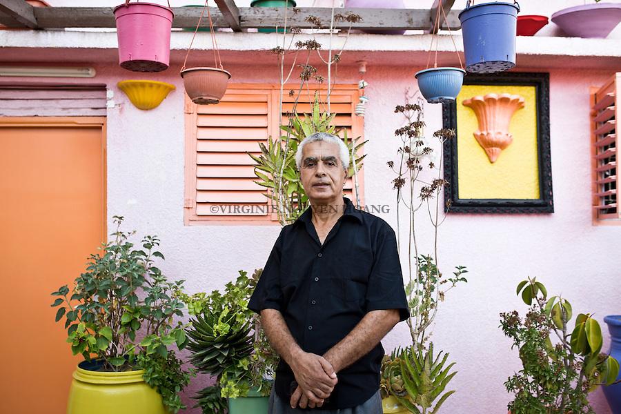 GAZA, Zaytoun: Mohammed Al Saedi, 58 years old is the initiator of the &quot;colordful street&quot; project. As a painter, he started to paint his home in different colors. Then he decided to spread the idea to his neighbours in order to create a better atmosphere in the streets, specially for the children. 14/08/15<br /> <br /> GAZA , Zaytoun : Mohammed Al Saedi , &acirc;g&eacute; de 58 ans est l'initiateur du projet &quot;the colorful street&quot;. En tant que peintre , il a commenc&eacute; &agrave; peindre sa maison en diff&eacute;rentes couleurs. Puis il a d&eacute;cid&eacute; de r&eacute;pandre l'id&eacute;e &agrave; ses voisins afin de cr&eacute;er une meilleure atmosph&egrave;re dans les rues,sp&eacute;cialement pour les enfants. 14/08/15