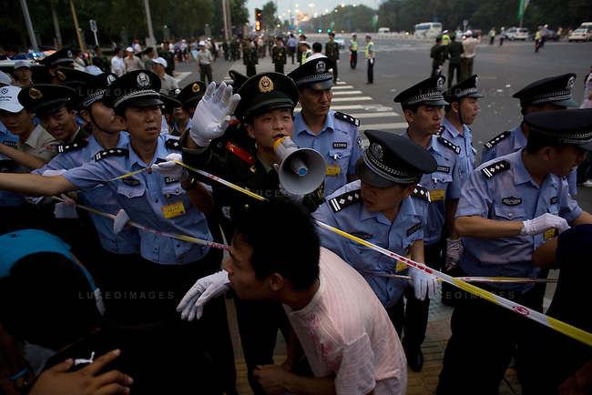 Chinese Olympic fans are blocked by police after trying to see the opening ceremony fireworks in Beijing, China on Friday, August 8, 2008.  Roads were shut down in every direction for miles. Kevin German