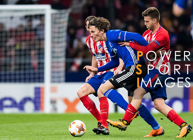Jonas Wind (C) of FC Copenhague competes for the ball with Diego Roberto Godin Leal (L) and Sergio Gonzalez Testan of Atletico de Madrid during the UEFA Europa League 2017-18 Round of 32 (2nd leg) match between Atletico de Madrid and FC Copenhague at Wanda Metropolitano  on February 22 2018 in Madrid, Spain. Photo by Diego Souto / Power Sport Images