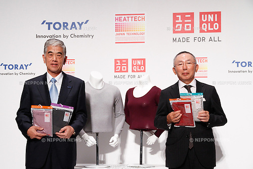 August 25, 2011, Tokyo, Japan - Tadashi Yanai, right, chief executive officer of Japans Fast Retailing Co., and Akihiro Nikkaku, president of Japans Toray Industries Inc., show revolutionary Heattech innerwear during a news conference in Tokyo on Thursday, August 25, 2011. Casual clothing store chain Uniqlo Co., a core unit of Fast Retailing, said it is aiming for 25% growth in sales volume globally for its Heattech line of thermal underwear this winter. Uniqlo and Toray Industries Inc., the nation's biggest synthetic fiber maker, have formed a strategic partnership under which they jointly develop new products and materials, with Heattech one successful example of their collaboration. Since Uniqlo started marketing Heattech products, cumulative sales to date total 199 million items.(Photo by AFLO) [3609] -mis-