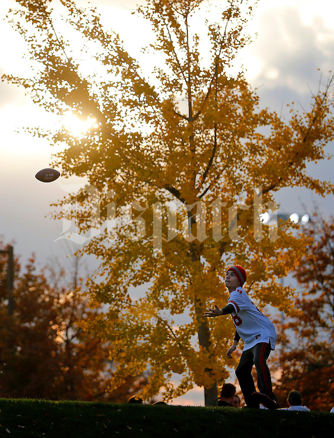 Matthew Lowry, 13, of Courtland, Ohio tosses a football with his friend Miles Wager, 12 (not pictured) before Saturday's NCAA Division I football game at Beaver Stadium in University Park, PA on October 25, 2014. (Columbus Dispatch photo by Jonathan Quilter)