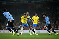 Neymar Jr of Brazil takes on the Uruguay defence during Brazil vs Uruguay, International Friendly Match Football at the Emirates Stadium on 16th November 2018