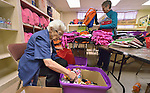 Sister Jo Murray (left) and Sally Lloyd assemble backpacks and bags of personal items for women and children who've been released from immigration detention facilities in Texas. The women have fled violence in Central America with their children and were detained by immigration authorities upon their arrival in the United States. After being released in San Antonio, they travel onward to stay with relatives elsewhere in the U.S., pending a final decision on their request for asylum. <br /> <br /> The backpacks and bags are assembled at El Divino Salvador United Methodist Church in San Antonio. The project is sponsored by the Interfaith Welcome Coalition. Lloyd is a member of University Presbyterian Church. Murray, a Roman Catholic, is a member of the Holy Spirit Sisters.