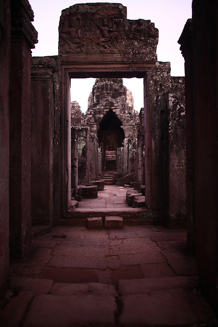 The ruins of Bayon, just after sunrise, at Angkor Thom, Cambodia. June 9, 2013.