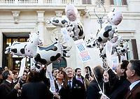 """I parlamentari dell'Italia dei Valori manifestano davanti alla Camera dei Deputati, Roma, 13 dicembre 2010, durante il dibattito sulla mozione di sfiducia al governo..Italia dei Valori party's lawmakers hold balloons depicting cows and signs reading """"Parliament, no cow market"""", during a protest in front of the Lower Chamber in Rome, 13 december, 2010..© UPDATE IMAGES PRESS/Riccardo De Luca"""