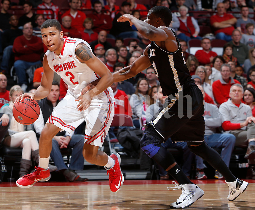 Ohio State Buckeyes forward Marc Loving (2) is guarded by Bryant University Bulldogs forward Alex Francis (23) during Wednesday's NCAA Division I basketball game at Value City Arena in Columbus on December 11, 2013. (Barbara J. Perenic/The Columbus Dispatch)
