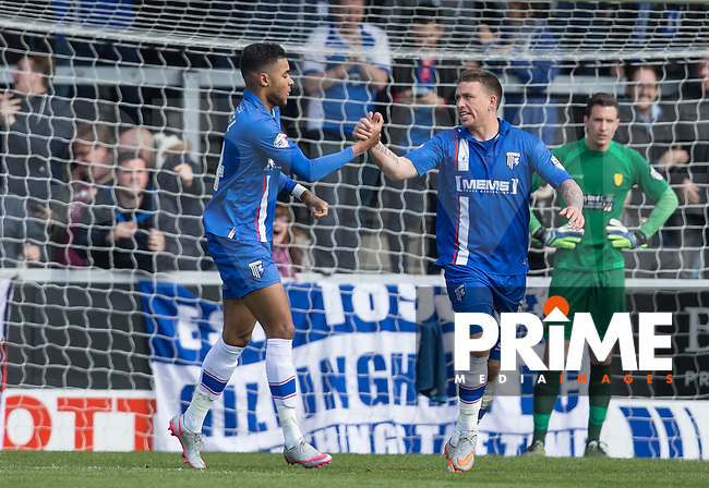 Dominic Samuel of Gillingham congratulates goal scorer Cody McDonald of Gillingham during the Sky Bet League 1 match between Burton Albion and Gillingham at the Pirelli Stadium, Burton upon Trent, England on 30 April 2016. Photo by Andy Rowland.