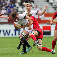 Katy Mclean tackled by Karen Paquin. WRWC England v Canada, World Cup Final at Stade Jean Bouin, Avenue du Général Sarrail, Paris, France, on 17th August 2014