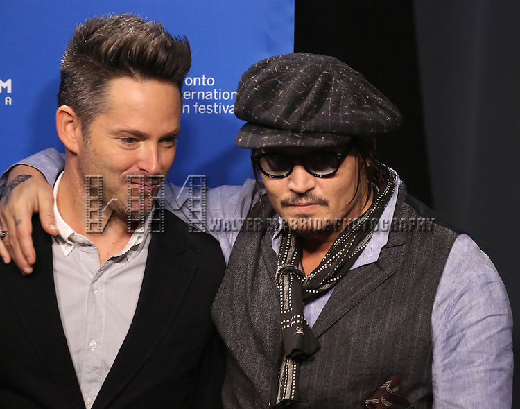 Scott Cooper and Johnny Depp attends the 'Black Mass' photo call during the 2015 Toronto International Film Festival at Roy Thomson Hall on September 14, 2015 in Toronto, Canada.
