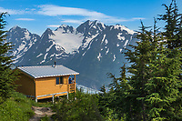Spence Bench Cabin overlooking the Spencer Glacier in the Chugach National Forest, Kenai Peninsula, Alaska.