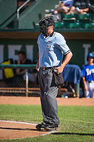 Home plate umpire Mike Rains handles the calls behind the plate during the Pioneer League game between the Ogden Raptors and the Grand Junction Rockies at Lindquist Field on July 5, 2015 in Ogden, Utah. Ogden defeated Grand Junction 12-2. (Stephen Smith/Four Seam Images)
