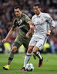 Cristiano Ronaldo (r) of Real Madrid battles for the ball with Tomasz Jodlowiec of Legia Warszawa during the 2016-17 UEFA Champions League match between Real Madrid and Legia Warszawa at the Santiago Bernabeu Stadium on 18 October 2016 in Madrid, Spain. Photo by Diego Gonzalez Souto / Power Sport Images