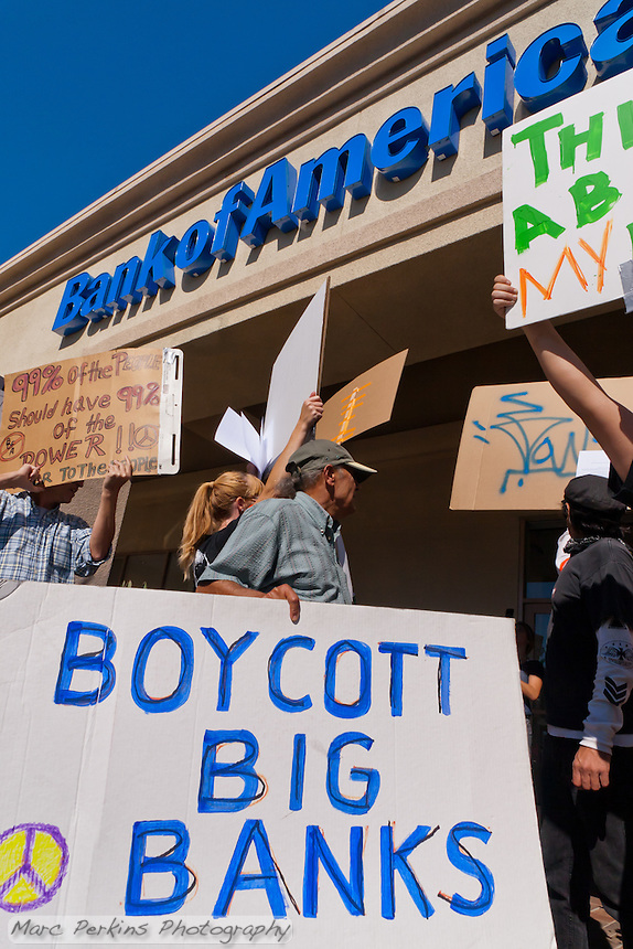 """A protester in the Occupy Orange County, Irvine march on November 5 holds a """"Boycott Big Banks"""" sign in front of the Bank of America in Irvine, CA."""
