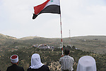 Druze men in Majdal Shams, Golan Heights, hold a pro-Syrian rally, watching people in Syria celebrate the Syrian independence day on Israel-Syria border.