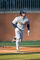 Hunter Kopycinski (4) of the Rice Owls hustles down the first base line against the Charlotte 49ers at Hayes Stadium on March 6, 2015 in Charlotte, North Carolina.  The Owls defeated the 49ers 4-2.  (Brian Westerholt/Four Seam Images)
