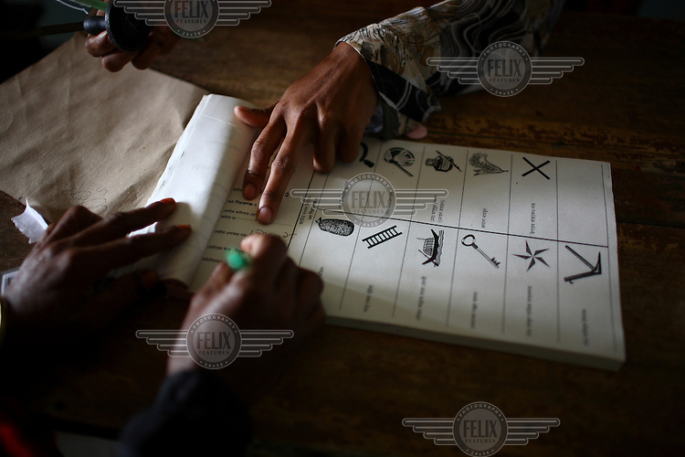 Processing voting ballots in the general election. The 2008 elections brought an end to almost two years of emergency rule in Bangladesh with a landslide victory for the Awami League-led grand alliance, which won 263 of the 300 available seats.