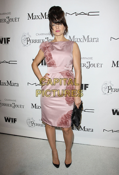 MENA SUVARI.3rd Annual Women In Film Pre-Oscar Party held At A Private Residence, Bel Air, California, USA..March 4th, 2010.full length sleeveless dress hand on hip pink hair fringe up silk chiffon ruffle ruffles black clutch bag shoes  .CAP/ADM/KB.©Kevan Brooks/AdMedia/Capital Pictures.