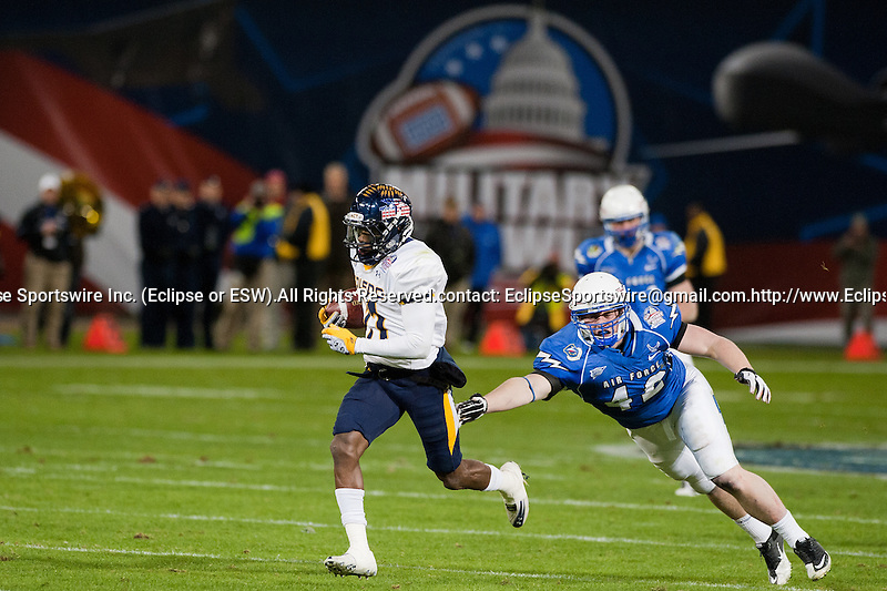 Toledo wide receiver Devin Brown (11) outruns Air Force defenders to score a touchdown during the first half in then Military Bowl at Robert F. Kennedy Stadium in Washington, D.C. on December 28, 2011.