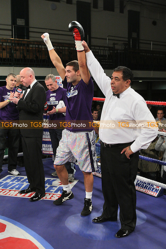 Steve O'Meara (silver shorts) defeats Nathan Weisse in a Light-Middleweight boxing contest for the Southern Area Title at York Hall, Bethnal Green, promoted by Frank Warren - 14/12/11 - MANDATORY CREDIT: Gavin Ellis/TGSPHOTO - Self billing applies where appropriate - 0845 094 6026 - contact@tgsphoto.co.uk - NO UNPAID USE..