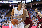 18 January 2014: North Carolina's James Michael McAdoo (43) is fouled by Boston College's Eddie Odio (right). The University of North Carolina Tar Heels played the Boston College Eagles in an NCAA Division I Men's basketball game at the Dean E. Smith Center in Chapel Hill, North Carolina. UNC won the game 82-71.