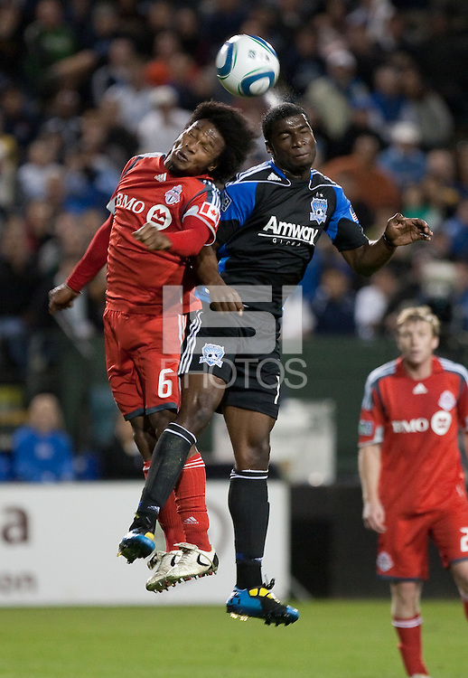 Julian de Guzman (6) and Brandon McDonald (right) go up for the header. Toronto FC defeated the San Jose Earthquakes 3-1 at Buck Shaw Stadium in Santa Clara, California on May 29th, 2010.