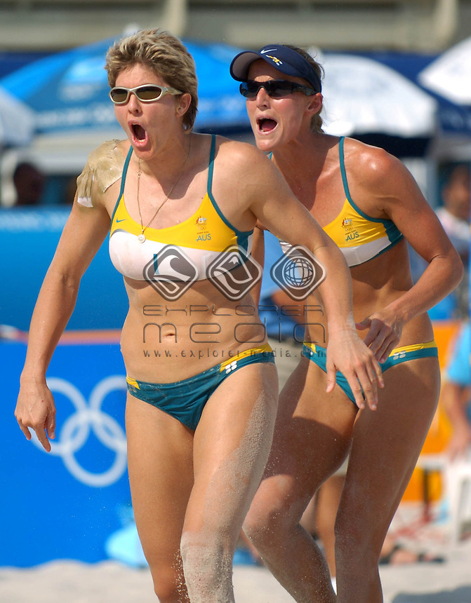 Natalie Cook and Nicole Sanderson get pumped up.<br /> Beach Volleyball - AUS Summer Lochowicz and Kerri Pottharst vs. AUS Natalie Cook and Nicole Sanderson.<br /> Summer Olympics - Athens, Greece 2004<br /> Day 7 ,20th August 2004.<br /> &copy; Sport the library/Courtney Harris