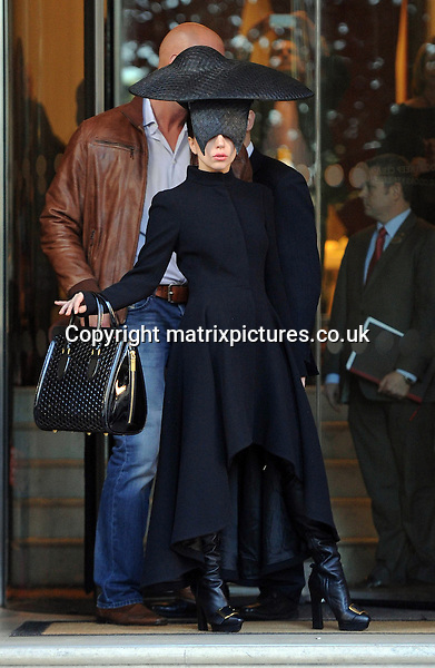 NON EXCLUSIVE PICTURE: PALACE LEE / MATRIXPICTURES.CO.UK<br /> PLEASE CREDIT ALL USES<br /> <br /> WORLD RIGHTS<br /> <br /> American pop star and singer-songwriter Lady Gaga is spotted leaving her hotel in central London, England.<br /> <br /> The eccentric singer is seen wearing an oversized black fascinator with visor, thigh-high leather boots and a sleek black coat with Chinese collar.<br /> <br /> OCTOBER 30th 2013<br /> <br /> REF: LTN 137064