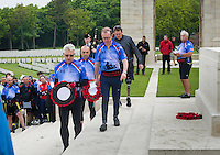 A wreath laying ceremony at the cemetery of Etaples,  the largest CWGC cemetery in France, containing 10,771 First World War burials of which only 35 remain unidentified, on the fourth day of the Help for Heroes Big Battlefields Bike Ride from Paris to London. The day commenced from Le Touquet and proceeded to Etaples, which had been home to the British Army's largest training camp during the Second World War, as well as having military prisons and hospitals. Here, in the War Cemetary at Etaples, in front of a memorial designed by Edwin Lutyens, a wreath laying ceremony was conducted. Lunch was taken just north of Boulogne, beside the Canadian Military Cemetary where Lt. Col. John McCrae was buried and a second wreath laying ceremony was held. Finally, before arriving at Calais, there was a visit to Mimoyecques, an old quarry from which the Germans created a substantial subterranean base, to house their V3 rocket, with which they hoped to destroy London. Friday 31st May 2013.