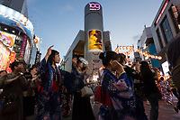 People enjoy dancing and watching the third Annual Shibuya Bon Odori festival, Bon dancing is a Japanese custom at summer matsuri or festivals all over Japan. The Shibuya Bon Odori takes place in front of the iconic Shibuya 109 building. Shibuya, Tokyo, Japan. Sunday August 4th 2019