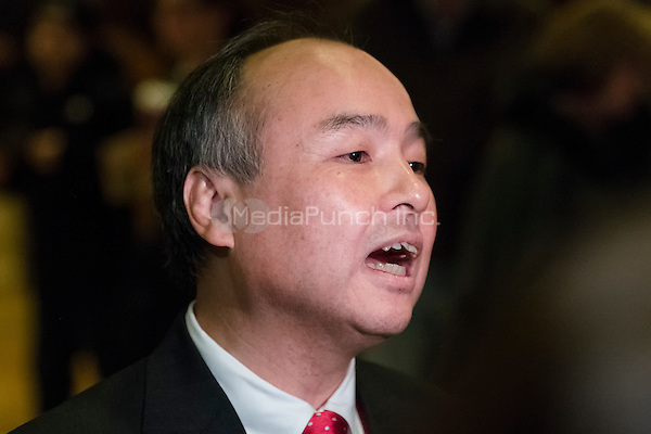 Son Masayoshi, CEO and founder of SoftBank, speaks to the press in the lobby of Trump Tower following his meeting with President-elect Donald Trump, in New York, NY, USA on December 6, 2016. (Photo by Albin Lohr-Jones)<br /> Credit: Albin Lohr-Jones / Pool via CNP /MediaPunch