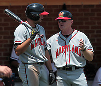 Maryland head coach John Szefc, right, talks with Maryland first baseman Lamonte Wade (6) in the third inning of an NCAA college baseball tournament super regional game against Maryland in Charlottesville, Va., Saturday, June 7, 2014. Maryland defeated Virginia 5-4. (AP Photo/Andrew Shurtleff)