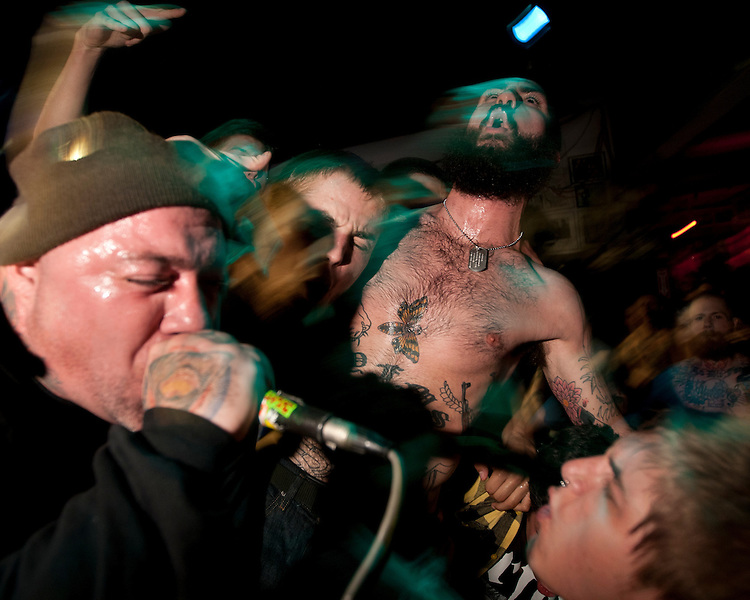 October 10, 2010 - Chris Drew, center, sings along to Joe Riverside Mahiques from the straight edge hardcore band Rhinoceros at the Mohawk Place, Buffalo, NY. Straight edge is a belief system of no smoking, no drinking, and no drugs.