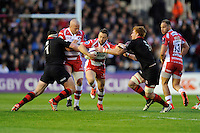 Greig Laidlaw of Gloucester Rugby finds his way blocked by Alasdair Dickinson and Roddy Grant of Edinburgh Rugby