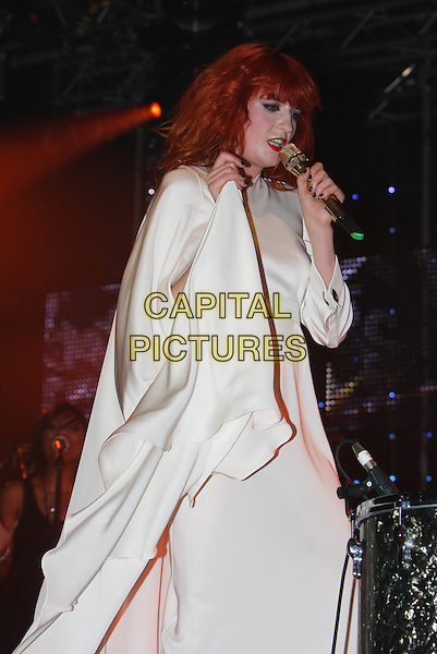 FLORENCE WELCH of FLORENCE AND THE MACHINE.Performs live during Radio One's Big Weekend, Bangor, North Wales, .UK, May 22nd 2010..1 1's music live on stage concert gig half length white cream long dress microphone hand arm raised up singing side .CAP/MAR.© Martin Harris/Capital Pictures.