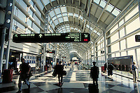 O'Hare Airport terminal interior, United concourse, with silhouettes of pilot and passengers. Chicago Illinois United States.