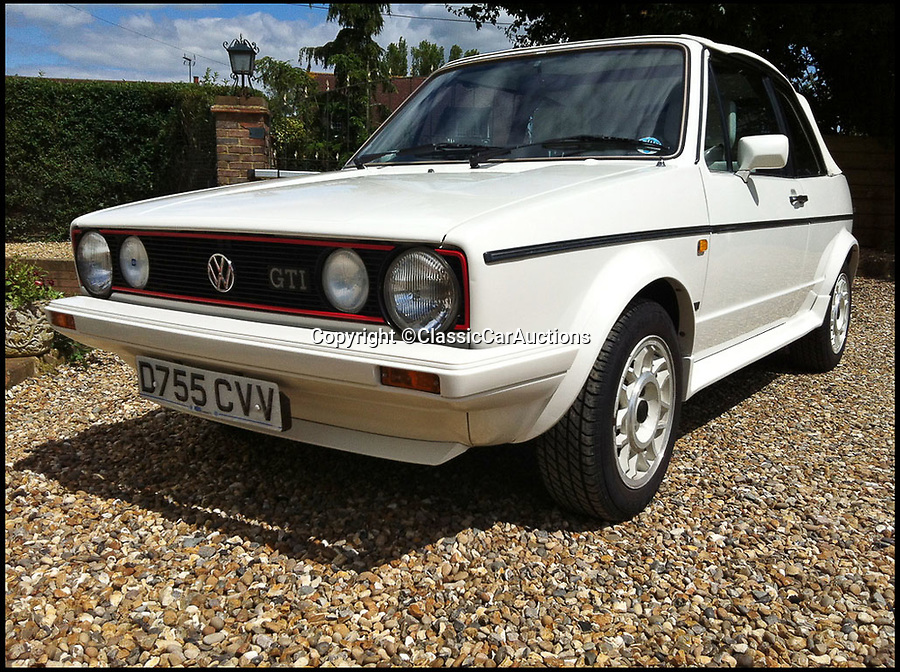 BNPS.co.uk (01202 558833)Pic: ClassicCarAuctions/BNPS<br /> <br /> Lovely V-Jubbly...<br /> <br /> An eighties' hot-hatch Only Fools and Horses star Sir David Jason once bought for his late partner has sold for almost £18,000.<br /> <br /> The legendary actor's purchase of the 1987 Volkswagen Golf GTi mimics the storyline in the hit sitcom when Del Boy bought a Ford Capri for his partner Raquel. <br /> <br /> In another episode Del used a play on the term 'GTi' to call dodgy car dealer friend Boycie a 'git'.<br /> <br /> Sir David bought the white convertible Golf as a gift for his late partner Myfanwy Talog in 1988, during the height of Only Fools and Horses.