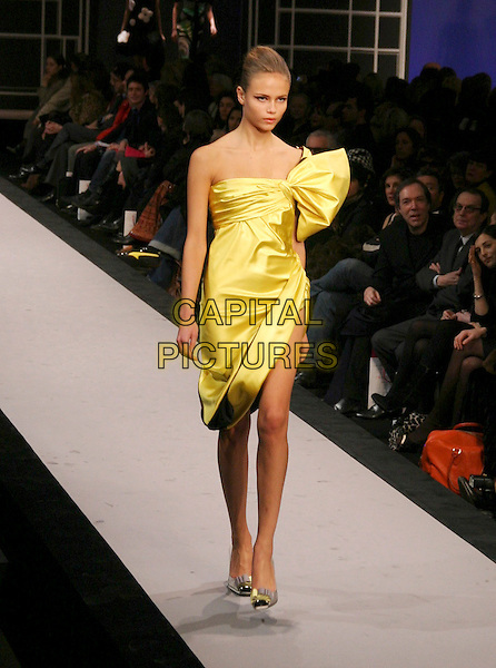MODEL.Ungaro Ready to Wear Autumn/Winter Fashion Show Collection 2005/2006, Paris, France, March 1st 2005..full length runway catwalk yellow gold strapless dress.**UK SALES ONLY**.Ref: MDS.www.capitalpictures.com.sales@capitalpictures.com.©Virgille Biechy/O.Medias/Capital Pictures .